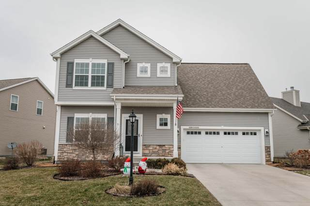 W206N16282 Marshland Dr, Jackson, WI 53037 (#1670564) :: Tom Didier Real Estate Team