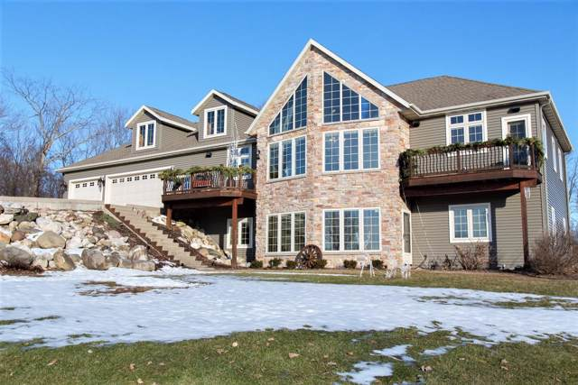 N1392 Pfister Ln, New Holstein, WI 53042 (#1672422) :: RE/MAX Service First Service First Pros