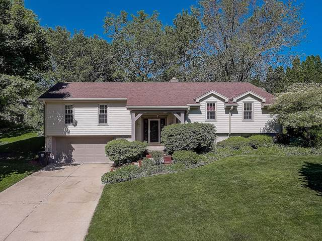 1057 N 123rd St, Wauwatosa, WI 53226 (#1673201) :: RE/MAX Service First Service First Pros