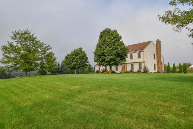 N86W30170 Woodland Dr, Merton, WI 53029 (#1674033) :: RE/MAX Service First Service First Pros