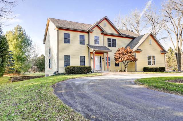 11245 N Buntrock Ave, Mequon, WI 53092 (#1674364) :: Tom Didier Real Estate Team