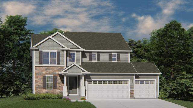 1089 Spruce Ct, Oconomowoc, WI 53066 (#1676945) :: RE/MAX Service First Service First Pros