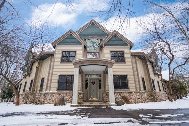 10903 N Beechwood Dr, Mequon, WI 53092 (#1676967) :: Tom Didier Real Estate Team