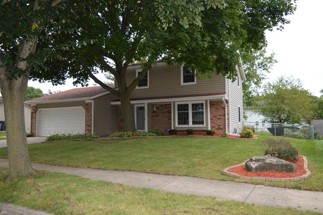 1709 Indianwood Ln, Waukesha, WI 53186 (#1677579) :: RE/MAX Service First Service First Pros