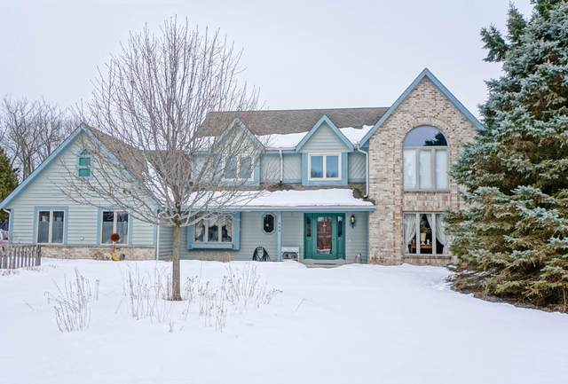 665 Seville Ct, Oconomowoc, WI 53066 (#1678143) :: RE/MAX Service First Service First Pros