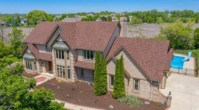 9130 W Kensington Way, Franklin, WI 53132 (#1679319) :: RE/MAX Service First Service First Pros