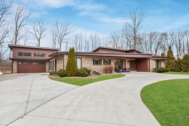 6747 N Holly Ct, Fox Point, WI 53217 (#1680893) :: Tom Didier Real Estate Team