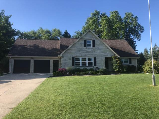 N64W14415 Mill Rd, Menomonee Falls, WI 53051 (#1681266) :: RE/MAX Service First Service First Pros