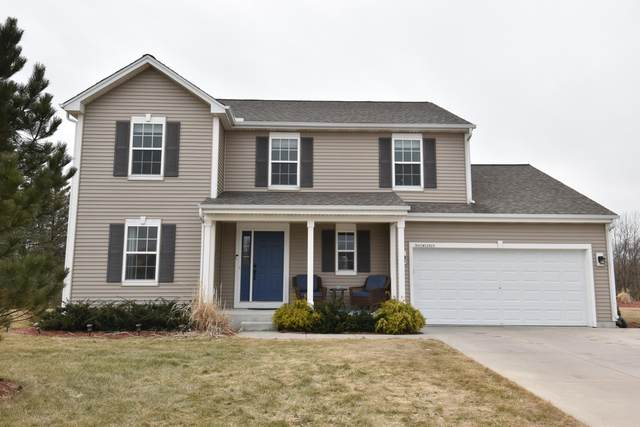 N41W22829 Sunder Creek Dr, Pewaukee, WI 53072 (#1682101) :: RE/MAX Service First Service First Pros