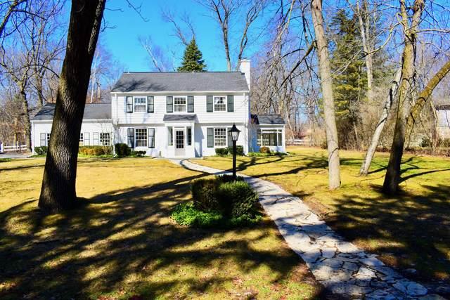 8254 N Gray Log Ln, Fox Point, WI 53217 (#1682419) :: Tom Didier Real Estate Team
