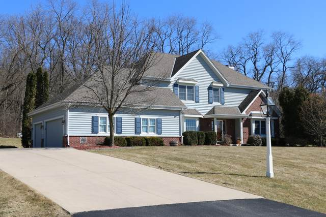 W282N4138 Somerset Ln, Delafield, WI 53072 (#1682624) :: RE/MAX Service First Service First Pros