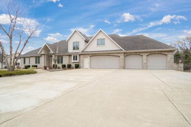S72W13838 Woods Rd, Muskego, WI 53150 (#1683455) :: Tom Didier Real Estate Team