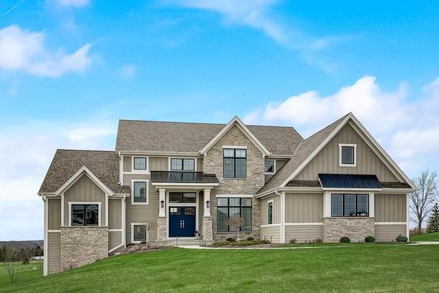 1628 Upland Ct, Hartland, WI 53029 (#1685963) :: RE/MAX Service First Service First Pros