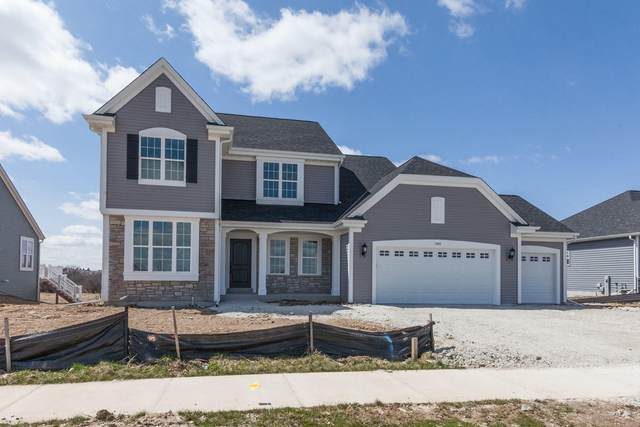 1351 Bluestem Trl, Oconomowoc, WI 53066 (#1686158) :: NextHome Prime Real Estate