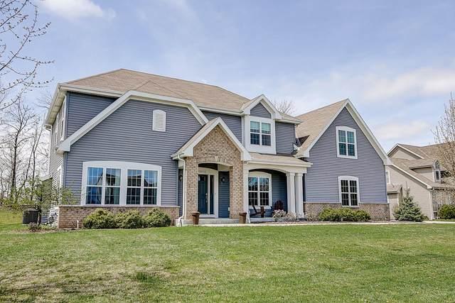 W193N5703 Canary Dr, Menomonee Falls, WI 53051 (#1686922) :: NextHome Prime Real Estate
