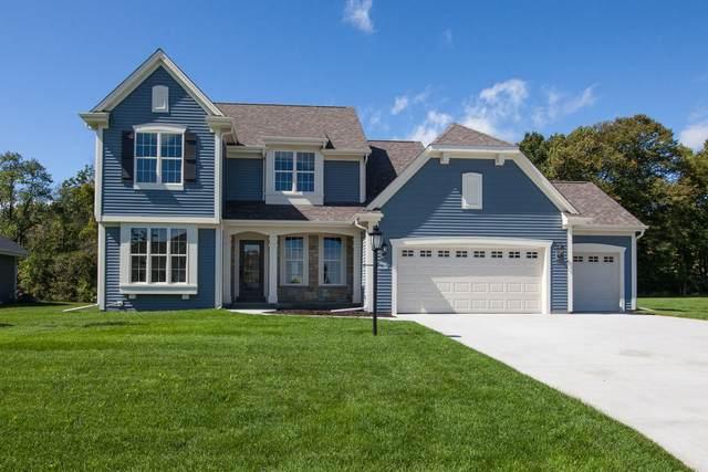 W224N4513 Seven Oaks Dr, Pewaukee, WI 53072 (#1687168) :: NextHome Prime Real Estate