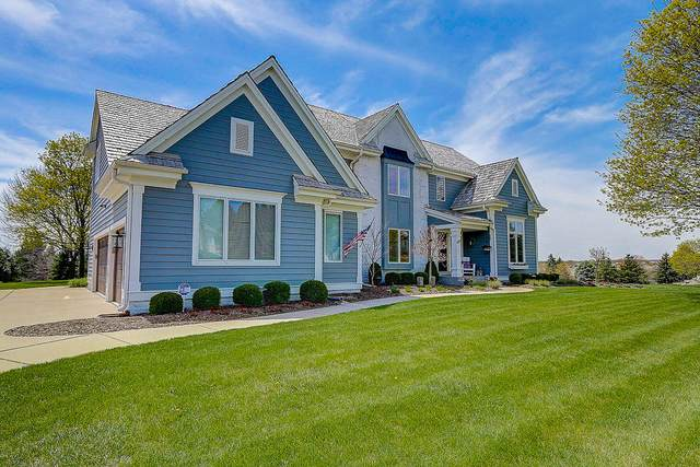 1005 N Bluespruce Cir, Hartland, WI 53029 (#1688609) :: NextHome Prime Real Estate