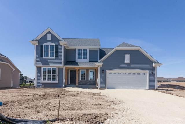 555 Spur Rd, Slinger, WI 53086 (#1689123) :: NextHome Prime Real Estate