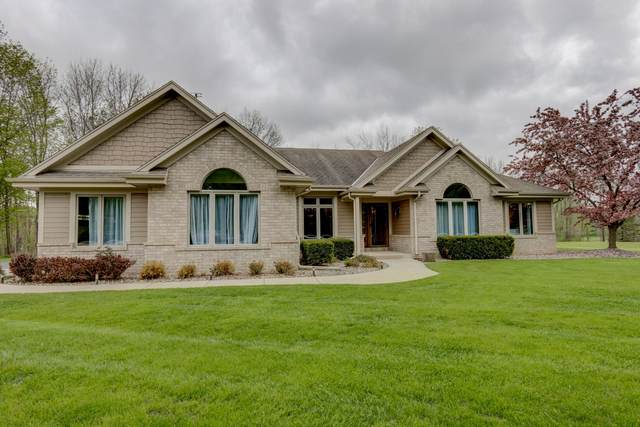 N43W23295 Beaver Ct, Pewaukee, WI 53072 (#1690436) :: RE/MAX Service First Service First Pros