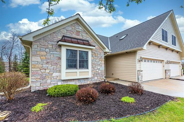 831 Lorrin Pl, West Bend, WI 53095 (#1690501) :: RE/MAX Service First Service First Pros