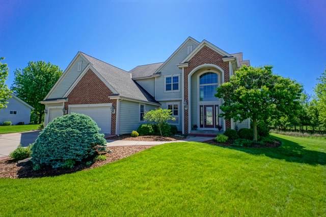 215 Shore Cir, Oconomowoc, WI 53066 (#1691273) :: OneTrust Real Estate