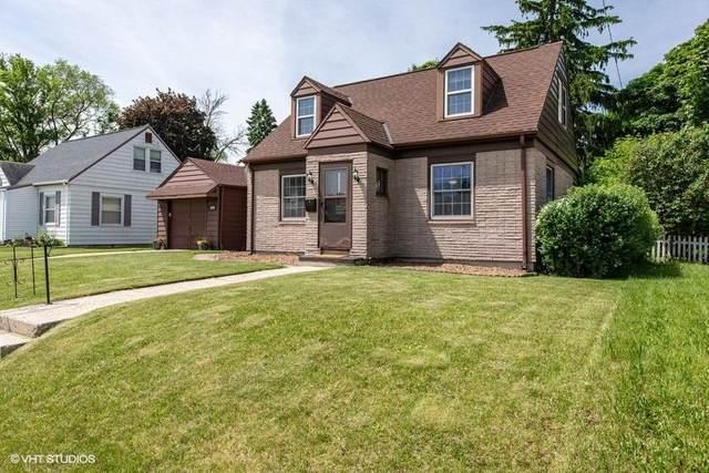 1030 Birchwood Dr, West Bend, WI 53095 (#1692037) :: Tom Didier Real Estate Team