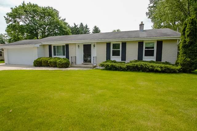 11721 W Grange Ave, Hales Corners, WI 53130 (#1692336) :: RE/MAX Service First Service First Pros
