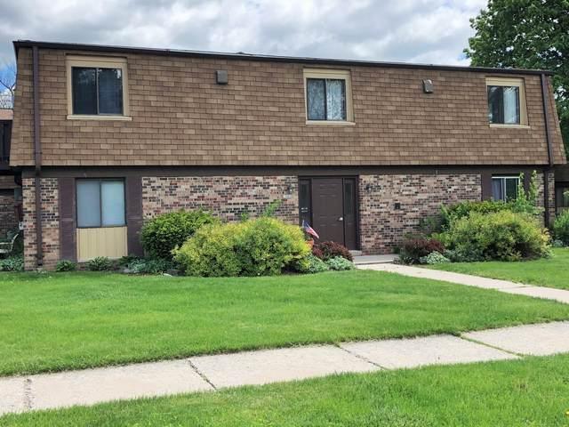 1201 Marcia Ave #102, West Bend, WI 53090 (#1692370) :: Tom Didier Real Estate Team