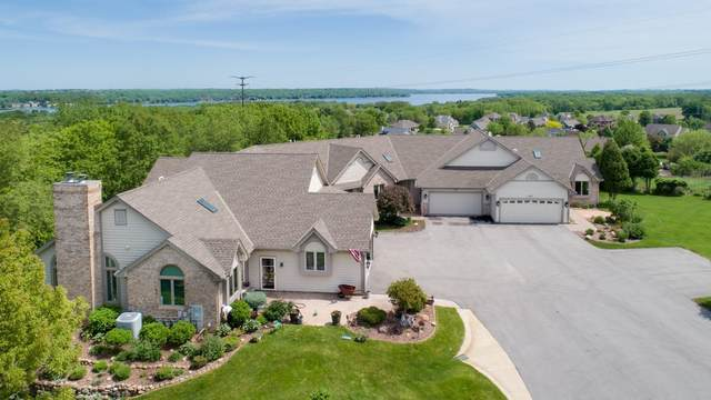 N14W30028 High Ridge Rd, Delafield, WI 53072 (#1692483) :: RE/MAX Service First Service First Pros