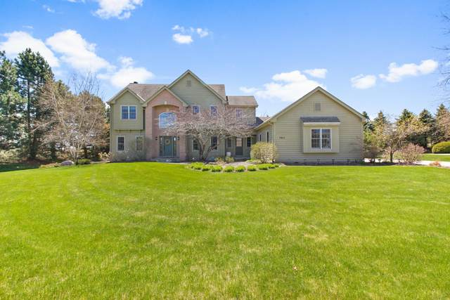 7911 W Eastfield Cir, Mequon, WI 53097 (#1694261) :: RE/MAX Service First Service First Pros