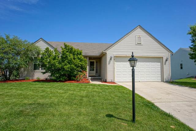 927 Hickory Creek Dr, Oconomowoc, WI 53066 (#1694477) :: OneTrust Real Estate