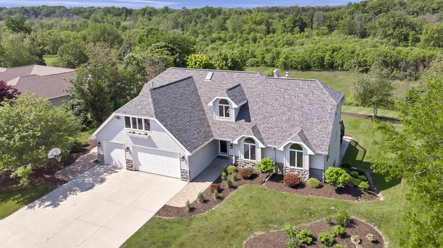229 River Oaks Dr, Sheboygan Falls, WI 53085 (#1694851) :: RE/MAX Service First Service First Pros