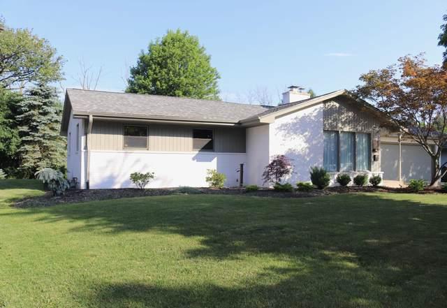 5490 Leroy Ln, Greendale, WI 53129 (#1697717) :: Tom Didier Real Estate Team