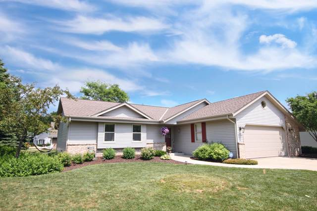 W145N10546 Heritage Hills Pkwy, Germantown, WI 53022 (#1697963) :: RE/MAX Service First Service First Pros