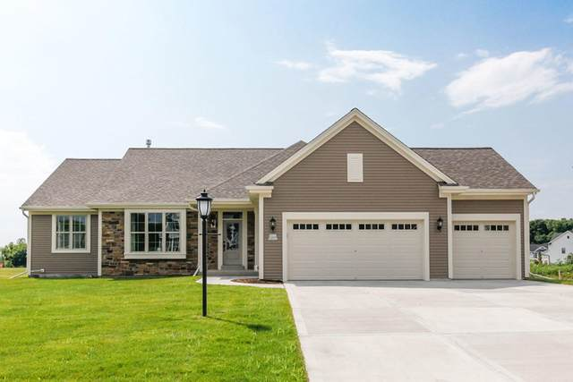 W223N4652 Seven Oaks Dr, Pewaukee, WI 53072 (#1698626) :: RE/MAX Service First Service First Pros