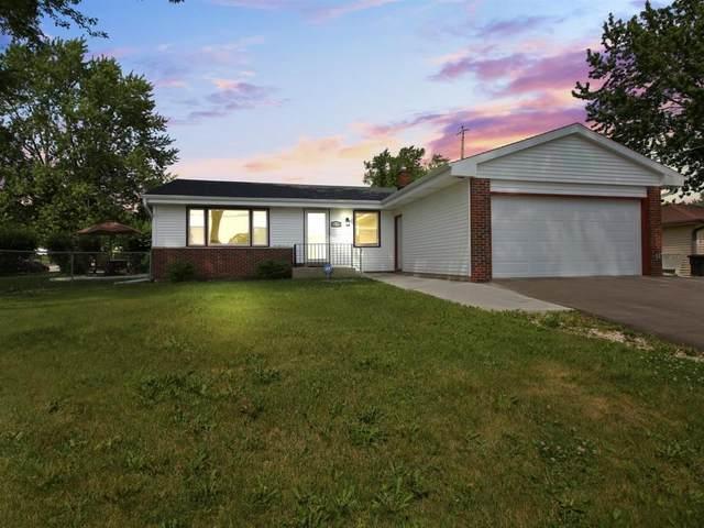 W180N8415 Town Hall Rd, Menomonee Falls, WI 53051 (#1699090) :: Tom Didier Real Estate Team