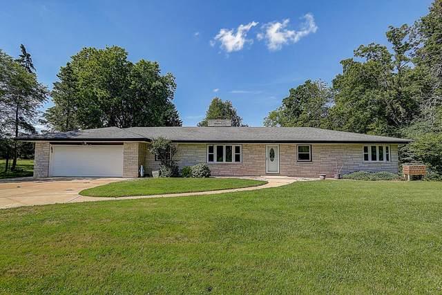 1502 E Cedar Creek Rd, Grafton, WI 53024 (#1699715) :: Tom Didier Real Estate Team