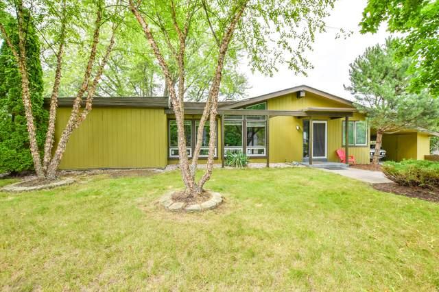 220 E Green Tree Rd, Fox Point, WI 53217 (#1700286) :: Tom Didier Real Estate Team