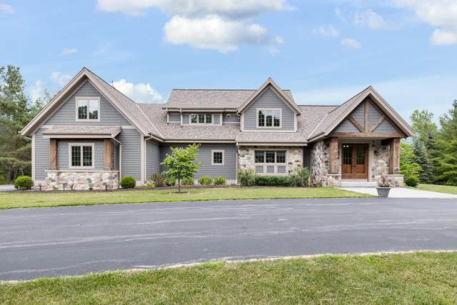 12828 N Fox Hollow Rd, Mequon, WI 53097 (#1702581) :: OneTrust Real Estate
