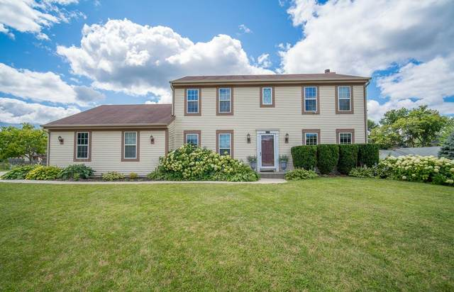 1101 Spruce St, West Bend, WI 53095 (#1702637) :: RE/MAX Service First Service First Pros