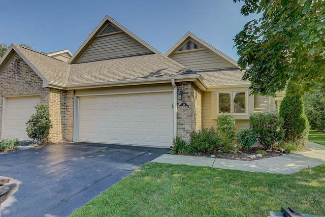 N21W24052 Dorchester Dr 6A, Pewaukee, WI 53072 (#1703284) :: RE/MAX Service First Service First Pros