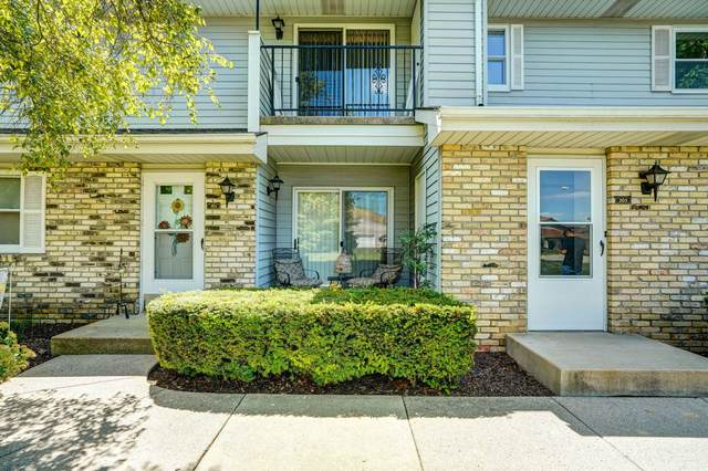 7041 Mariner Dr #103, Mount Pleasant, WI 53406 (#1703434) :: Tom Didier Real Estate Team