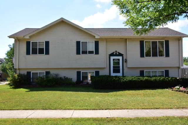 121 Rivera Dr, Waukesha, WI 53189 (#1703563) :: RE/MAX Service First Service First Pros