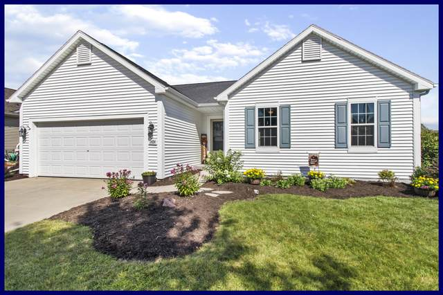 1404 Dovetail Dr, Hartford, WI 53027 (#1704491) :: NextHome Prime Real Estate