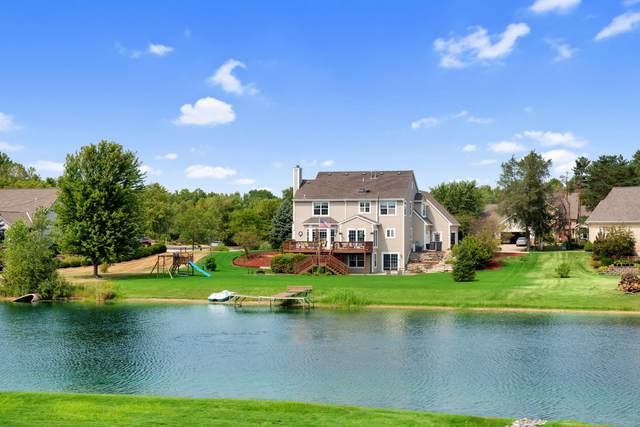 411 Sand Hill Ln, Dousman, WI 53118 (#1706936) :: Tom Didier Real Estate Team