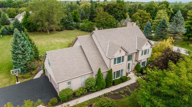 7914 W Eastfield Cir, Mequon, WI 53097 (#1708048) :: RE/MAX Service First Service First Pros