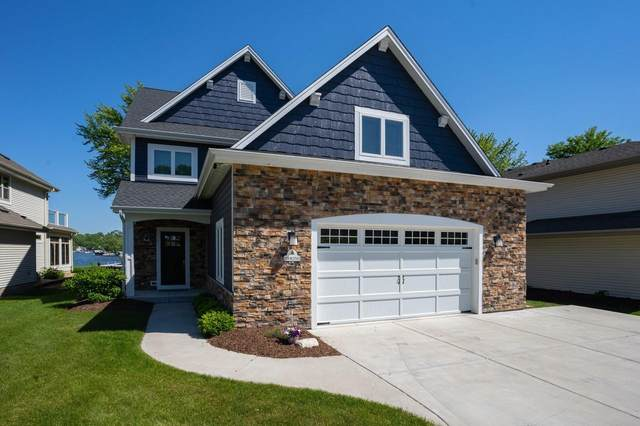 N28W27559 Peninsula Dr, Pewaukee, WI 53072 (#1708307) :: RE/MAX Service First Service First Pros