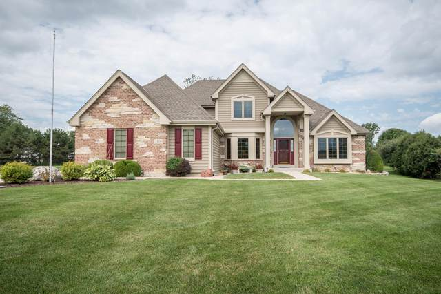 8529 S Parkland Dr, Franklin, WI 53132 (#1708320) :: RE/MAX Service First Service First Pros