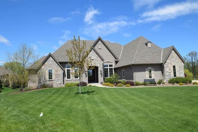 W247N2177 Lone Oak Ct, Pewaukee, WI 53072 (#1708646) :: RE/MAX Service First Service First Pros