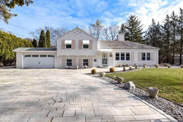 7126 N Lake Dr, Fox Point, WI 53217 (#1710902) :: Tom Didier Real Estate Team